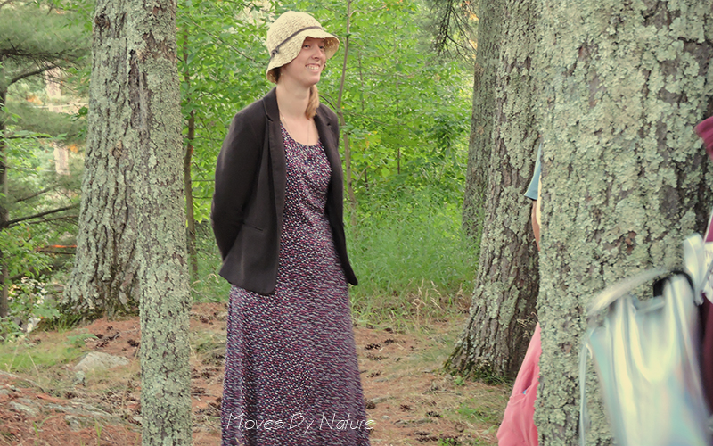 Woman in forest wearing a hat and dress